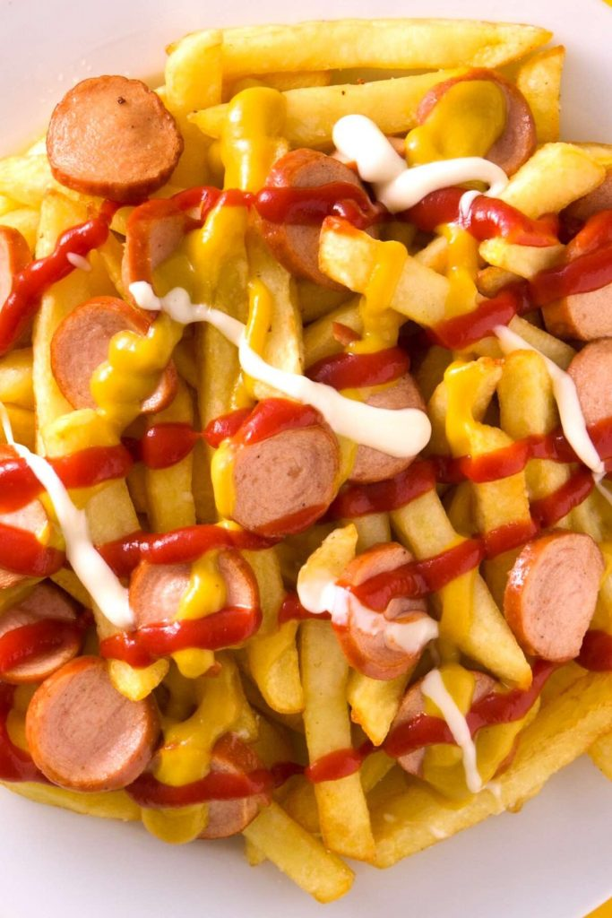 Salchipapas is local Peruvian street food. But you can easily make it at home with homemade French fries and pan-fried hot dogs. This fast food is perfect for parties, game days, or other special occasions when you crave a tasty and comfort appetizer or meal. #Salchipapa #Salchipapas