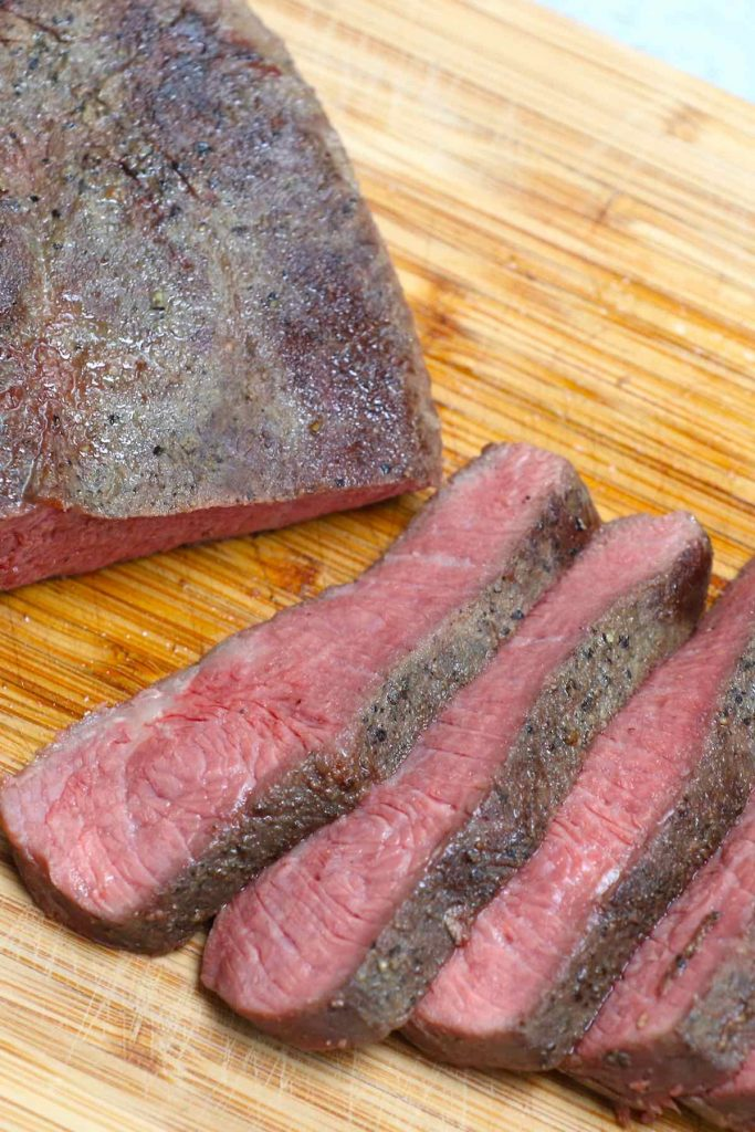 Sous Vide Flat Iron Steak is an easy and foolproof recipe to cook this affordable cut, delivering intense beef flavor with a very tender texture. Cooking it to a precise temperature in the sous vide water bath and finishing with a quick pan sear produce the best result. #SousVideFlatIronSteak