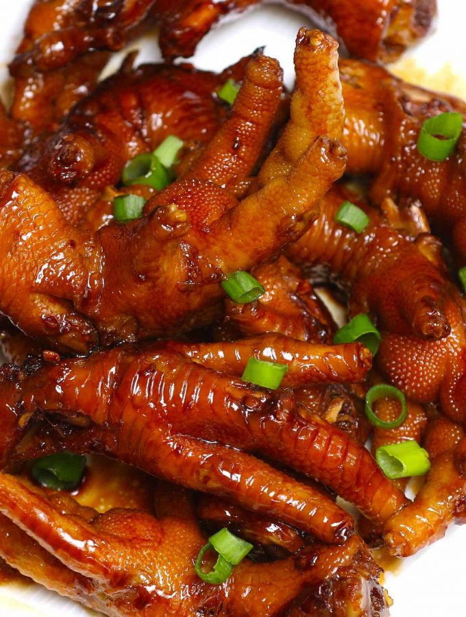 These braised Chicken Feet are cooked long and slow in a rich sauce – so tender and flavorful! This healthy recipe rivals what you would find in the best Chinese Dim Sum restaurant. The best part? No deep-frying required! #ChickenFeet #ChickenFeetRecipe #ChickenFeetDimSum