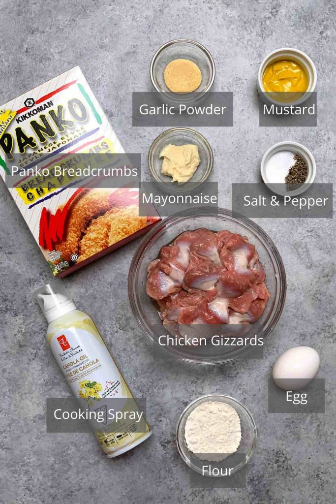 Oven fried chicken gizzards ingredients on the counter.