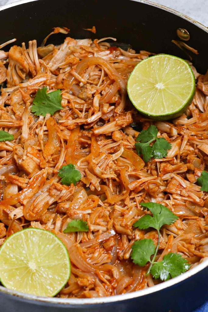 Learn everything about jackfruit including its nutrition, health benefits, how to cut, how to eat and some popular jackfruit recipes. This tropical fruit has increased in popularity as a healthy vegan meat substitute, in all kinds of recipes like jackfruit tacos, sandwiches, dips and curries. They're so delicious that you won't believe they're completely vegan! #Jackfruit #JackfruitRecipes #JackfruitTacos