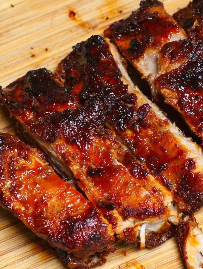 These are the best Air Fryer Ribs – so tender, crispy, and flavorful but not fall-off-the-bone! It's a super easy recipe that takes 30 minutes to make. Baby back ribs are seasoned with a simple dry rub, and then cooked in the air fryer, finally coated with a homemade sticky barbecue sauce. They are juicy, finger-licking delicious pork ribs and so addictive! #AirFryerRibs #AirFryerPorkRibs #AirFryerBabyBackRibs