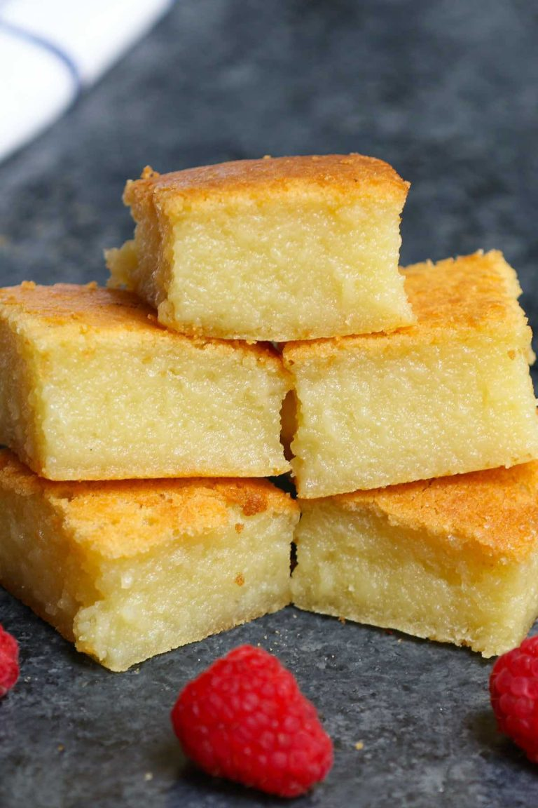 This classic Hawaiian Butter Mochi is soft, sticky, chewy, and buttery – melt-in-your-mouth delicious! A tropical treat made with mochiko glutinous rice flour and coconut cream, this mochi cake is incredibly easy to make. Here's a step-by-step guide on how to make this dessert at home. #ButterMochi #ButterMochiRecipe #HawaiianButterMochi