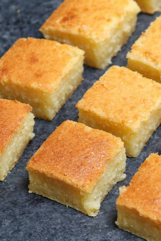 Closeup of freshly baked butter mochi squares.