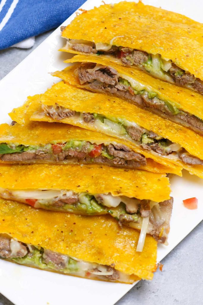 Mulitas are basically a double-deck quesadilla with two tortillas and meat on the inside. They're loaded with gooey melted cheese and a flavorful carne asada, with crispy tacos on both sides. Talk about mouth-watering Mexican comfort food everyone loves! #Mulitas