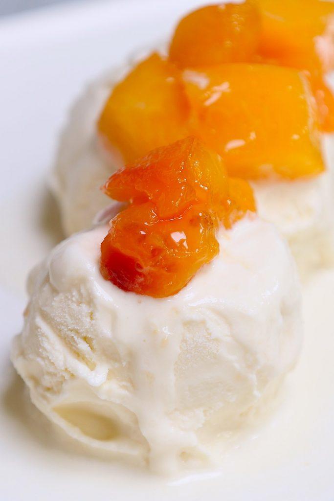 Peach compote served over ice cream.