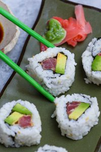The Spicy Tuna Roll is a classic Japanese sushi roll – smooth, creamy, and fiery spicy. Nori seaweed sheet is filled with seasoned sushi rice, avocado, and sashimi-grade tuna that's tossed in sriracha spicy mayo. This hand roll recipe takes about 15 minutes from start to finish once the sushi rice is ready. I'll share with you the secrets to make the best tuna sushi with a step-by-step guide! #SpicyTunaRoll #TunaSushi