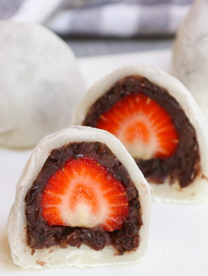 Looking for an indulgent and refreshing dessert recipe? Try Strawberry Mochi! The fresh, juicy strawberry and sweet red bean paste are covered with the chewy and soft mochi cake. This beautiful Japanese strawberry ichigo daifuku mochi is quick to make, and you can easily customize it for ice cream or red bean filled mochi balls! #StrawberryMochi #StrawberryDaifuku #IchigoDaifuku
