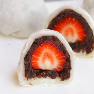 Looking for an indulgent and refreshing dessert recipe? Try Strawberry Mochi! The fresh, juicy strawberry and sweet red bean paste are covered with the chewy and soft mochi cake. This beautiful Japanese strawberry ichigo daifuku mochi is quick to make, and you can easily customize it for ice cream or red bean filled mochi balls!