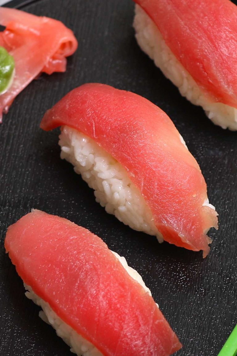 Tuna Nigiri is made with sashimi-grade tuna and vinegared sushi rice – so much easier to make than maki sushi rolls! We'll show you some simple techniques and tips so that you can make this delicious tuna sushi at home. Plus you'll find how to cut raw tuna and customize this recipe by using cooked tuna or other seafood, or alternatives like vegetables. #TunaNigiri