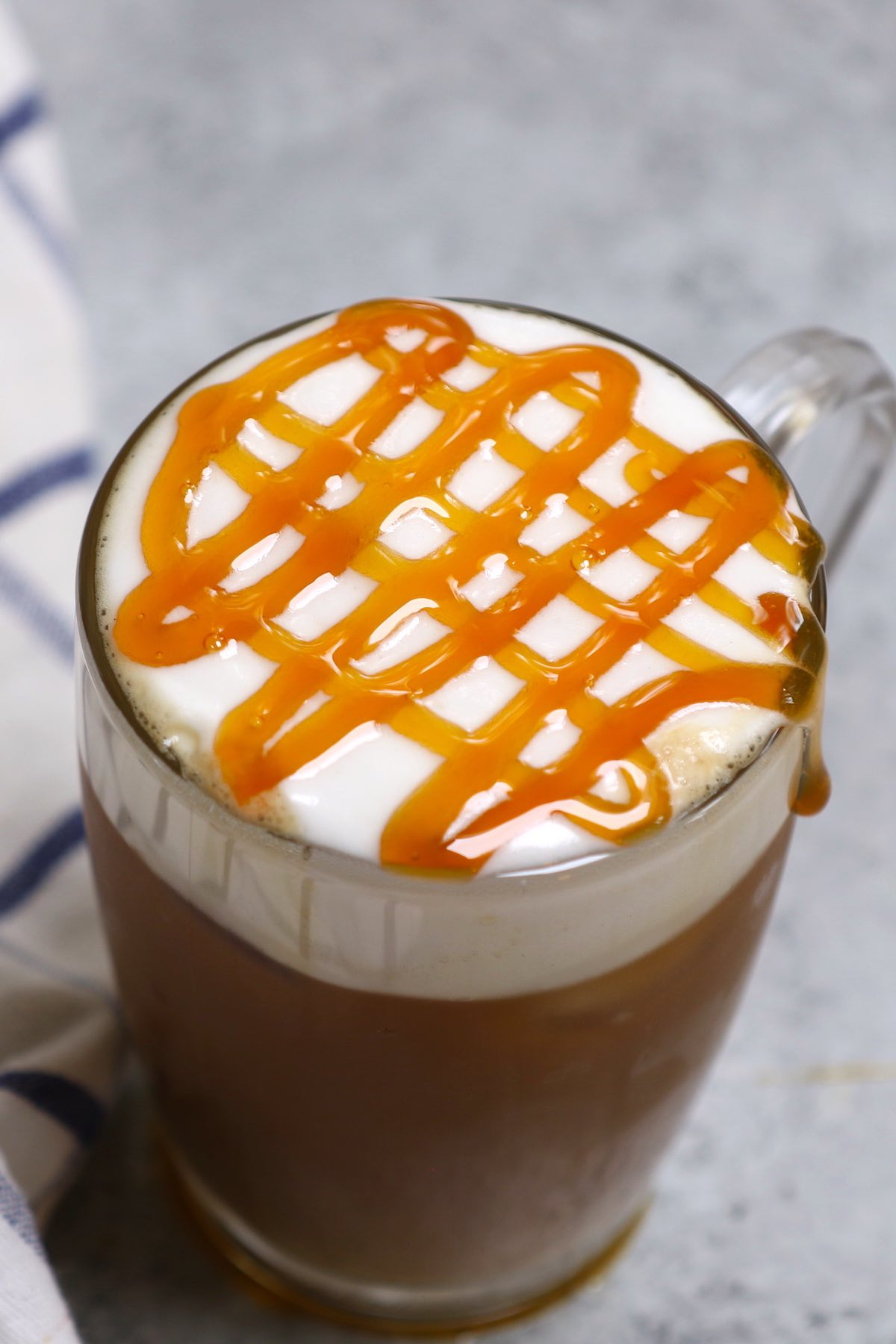 Try this copycat recipe of the popular Starbucks drink – Caramel Could Macchiato! Airy, foamy, full of delicious espresso and vanilla flavor, then topped with buttery caramel sauce. This Starbucks cloud macchiato recipe is not to be missed! #IcedCloudMacchiato #CloudMacchiato #CaramelCloudMacchiato