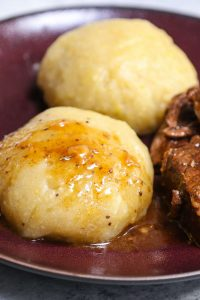 Fufu is a staple food in many countries in West Africa, Central Africa, and Caribbean. Traditionally it can be made with starchy food like cassava, yams or plantains. This easy fufu recipe boils cassava and plantains first, and then blend them into a dough-like consistency. Finally, it's shaped into small balls and served with soup, stew, or sauce. So satisfying and delicious! #fufu #AfricanFufu
