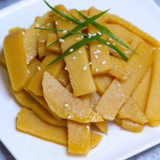 Menma is a popular Japanese condiment that's slightly crunchy and full of flavors. It's made from lactate-fermented bamboo shoots, and often used as a topping for ramen noodles. In this post you'll learn everything about Menma food and how to make menma for ramen in less than 15 minutes.