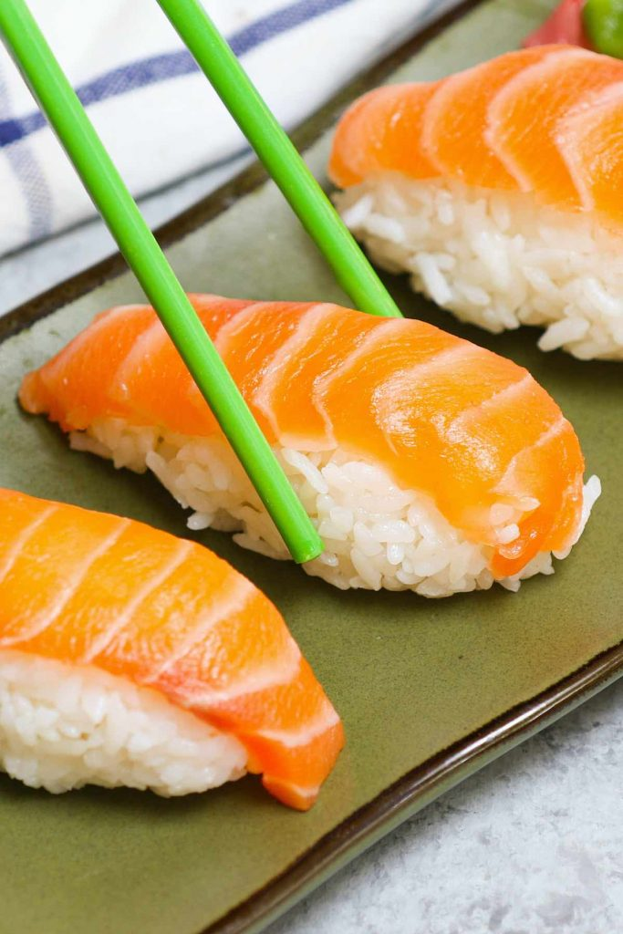 Salmon Nigiri made with sashimi-grade salmon and fluffy sushi rice! It's so much cheaper than the restaurant, and incredibly easy to make at home. I'll share with you the secrets to cut salmon for nigiri or sashimi and how to make salmon nigiri sushi with step by step photos.