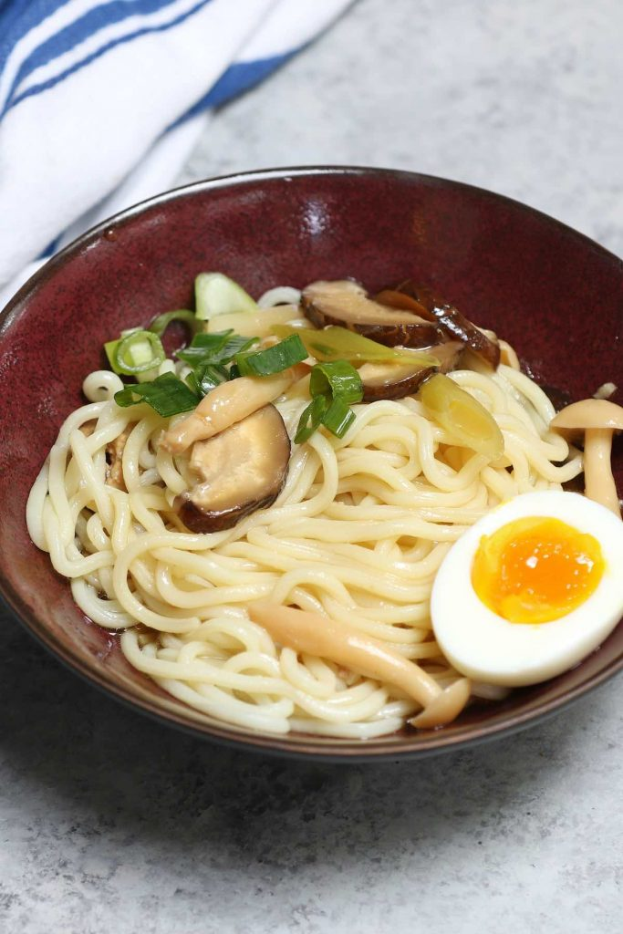 Easy homemade Tsukemen is rich and comforting with Japanese ramen noodles, a flavorful dipping broth, tender pork belly, fresh veggies, and a soft cooked egg. It's tastier and healthier than the restaurant version, but on the table in less than 30 minutes. #Tsukemen #TsukemenRamen