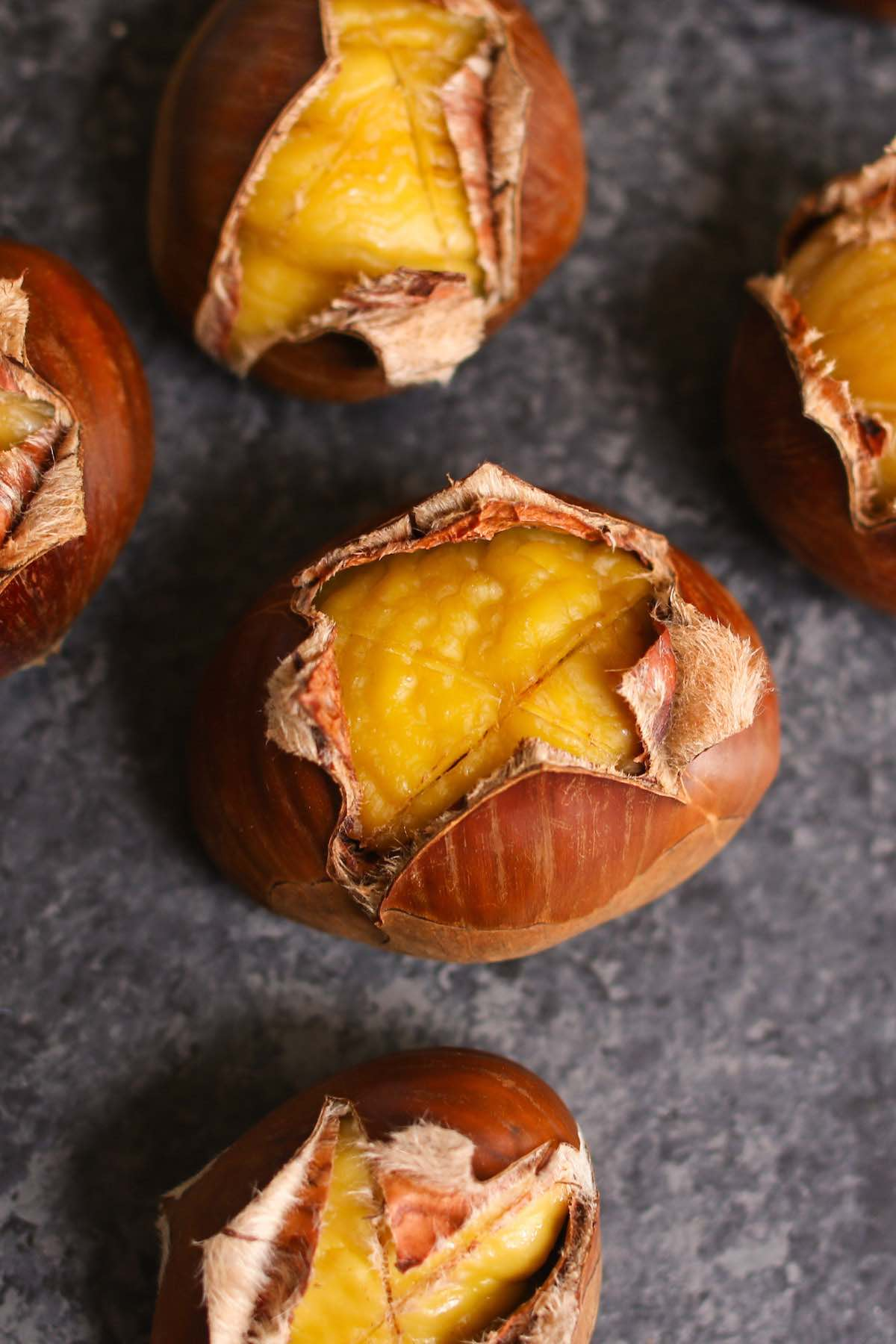 """If you are familiar with the Christmas song """"Chestnuts roasting on an open fire"""", then try making this special treat at home this year! Roasted Chestnuts are a great holiday appetizer and a healthy snack that's sweet with a nutty flavor."""