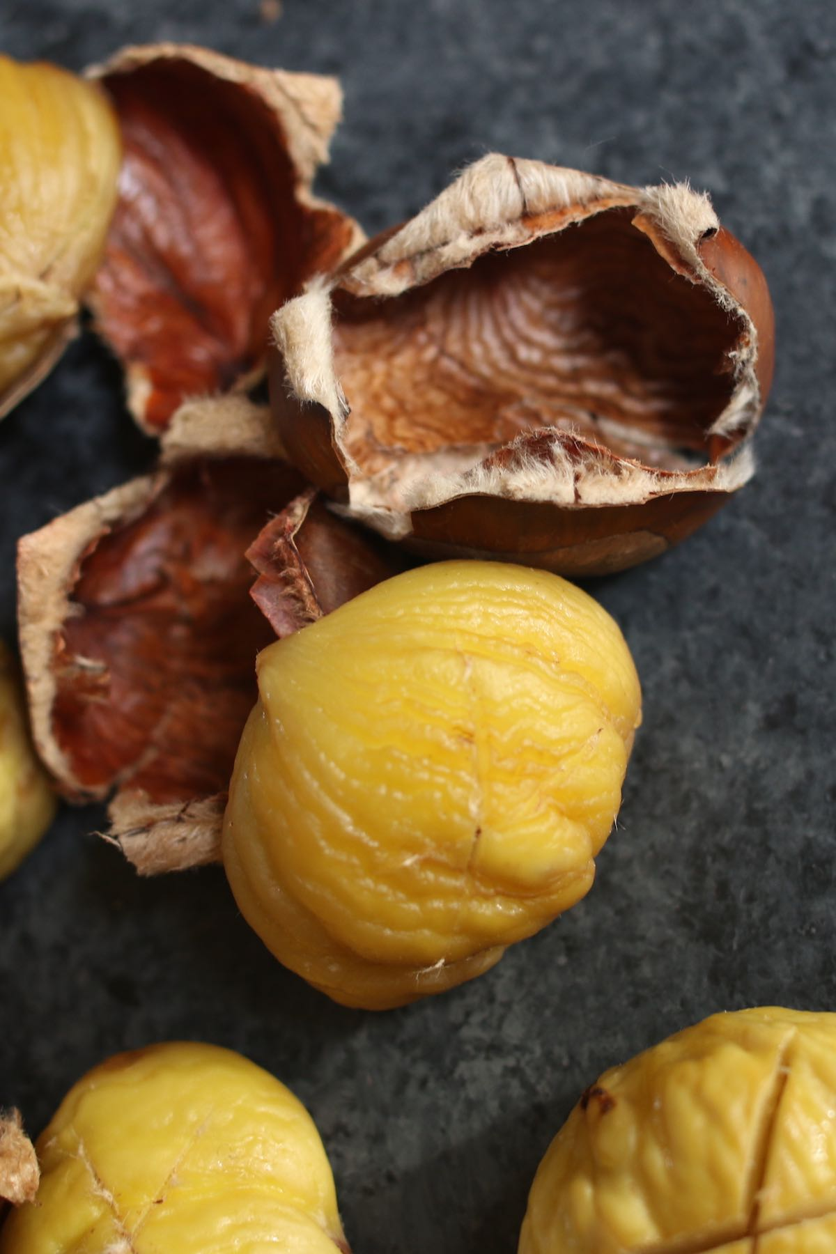Closeup showing peeled chestnusts.