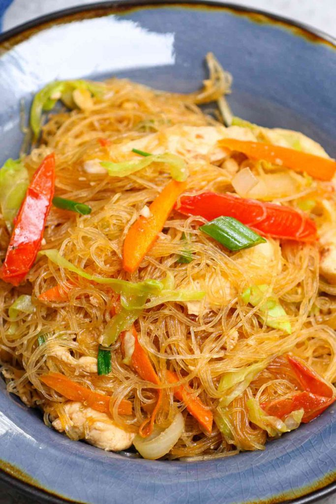 This amazing Pad Woon Sen recipe is surprisingly easy to make at home in under 30 minutes. It's a Thai stir fried noodle dish made with glass noodles, proteins, veggies tossed in a savory and slightly sweet pad woon sen sauce.  It tastes like it came from your favorite Thai restaurant. #PadWoonSen #PadWoonSenRecipe #PadThaiWoonSen