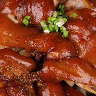 Braised Pig's Feet are tender, juicy, and flavorful – cooked long and slow in a rich sauce. Pig feet or pig trotters are considered one of the most delicious parts of pork. My family make this recipe for regular weekdays and special occasions like Chinese New Year. Serve them with mashed potatoes and green vegetables for an amazing meal! #PigFeet #PigFeetRecipe #PigTrotters #PorkFeet