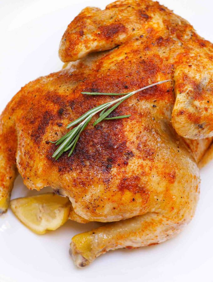 """Sous Vide Whole Chicken is one of the most delicious recipes for a whole chicken – tender, juicy, and perfectly """"roasted"""" rotisserie-style chicken (not poached) in your sous vide water bath! It's gluten-free, paleo, and whole 30. #SousVideWholeChicken"""