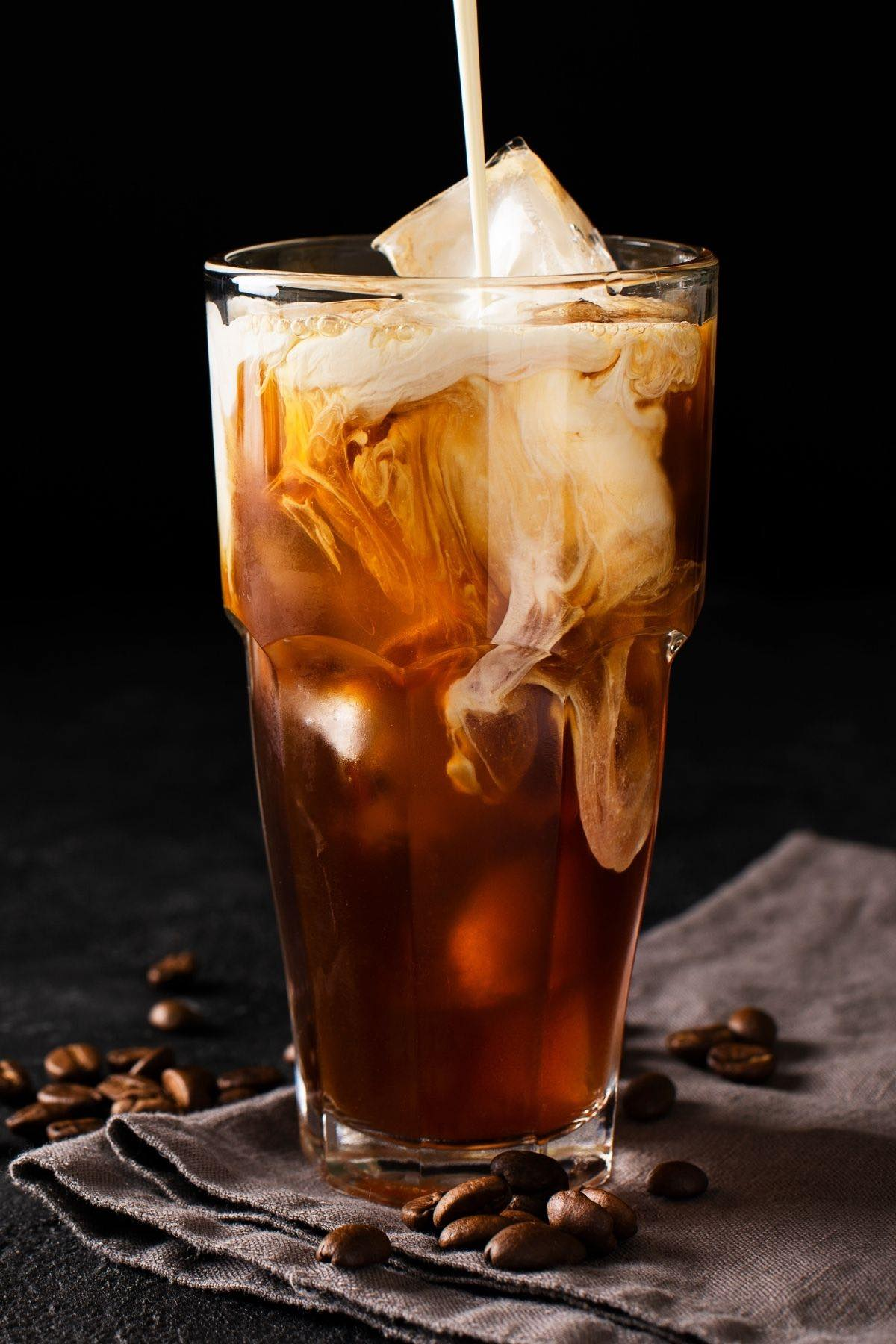 No fancy gear needed to make this Starbucks Copycat Vanilla Sweet Cream Cold Brew at home! Made with a few simple ingredients, it's sweet, creamy, and full of iced coffee flavor. I'll show you the correct cold brew coffee ratios and how to make the perfect vanilla sweet cream! At the fraction of the price, it's so easy to make and you can now enjoy it regularly!