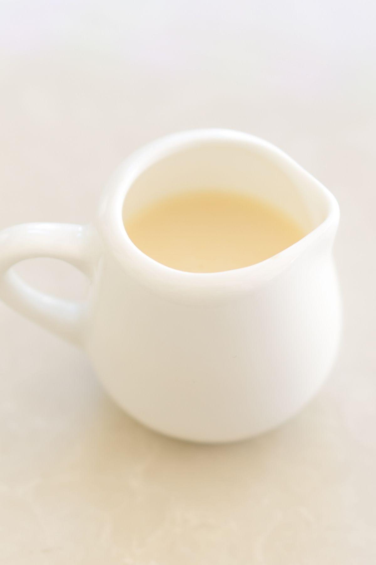 Vanilla sweet cream in a white jar.