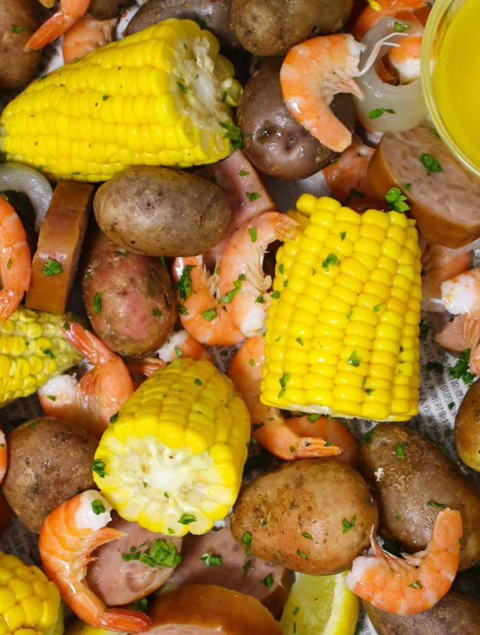 Low Country Boil is a Southern favorite that's a great crowd pleaser! Tender shrimp are boiled with hearty potatoes, smoked sausage, sweet corn, and the delicious old bay seasoning. This easy one-pot meal is perfect for a party as well as a casual weeknight dinner! #LowCountryBoil #FrogmoreStew