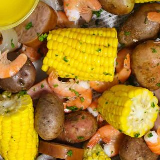 Low Country Boil is a Southern favorite that's a great crowd pleaser! Tender shrimp are boiled with hearty potatoes, smoked sausage, sweet corn, and the delicious old bay seasoning. This easy one-pot meal is perfect for a party as well as a casual weeknight dinner!