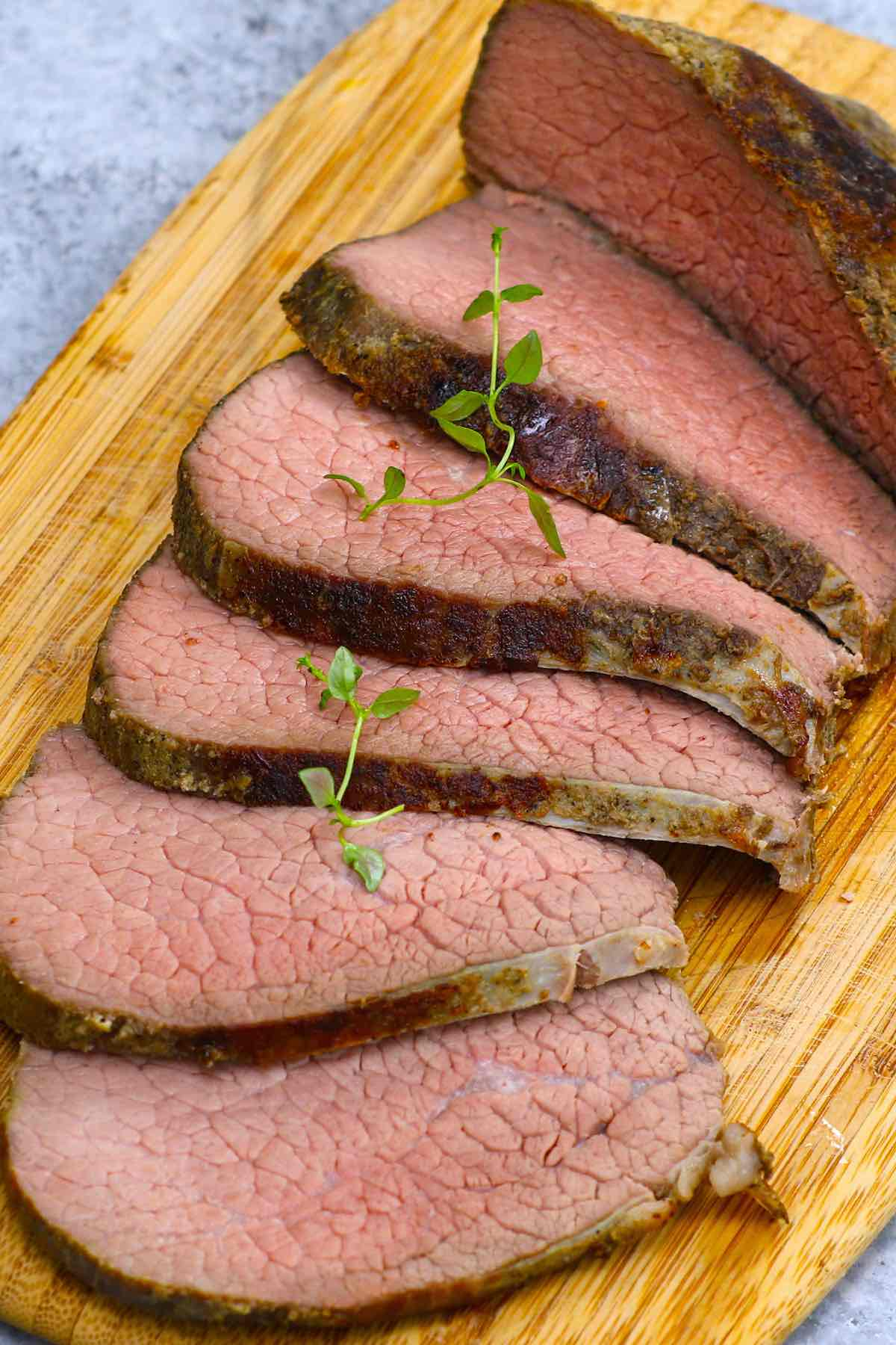 Sous Vide Eye of Round is the best way to cook this affordable beef cut, turning it into the most tender and juicy roast! This 16-hour low and slow sous vide method transforms the tough cut into a delicious eye of round roast that's perfectly moist from edge to edge. Great for a festive holiday meal on a budget! #SousVideEyeOfRound