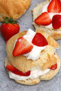 The easiest Bisquick Strawberry Shortcake made with original Bisquick pancake mix! Featuring fluffy Bisquick shortcakes layered with delicious strawberries and fresh whipped cream, these light and sweet biscuits are made with a few simple ingredients. A perfect summer dessert that's sure to please everyone! #BisquickStrawberryShortCake #BisquickShortcake
