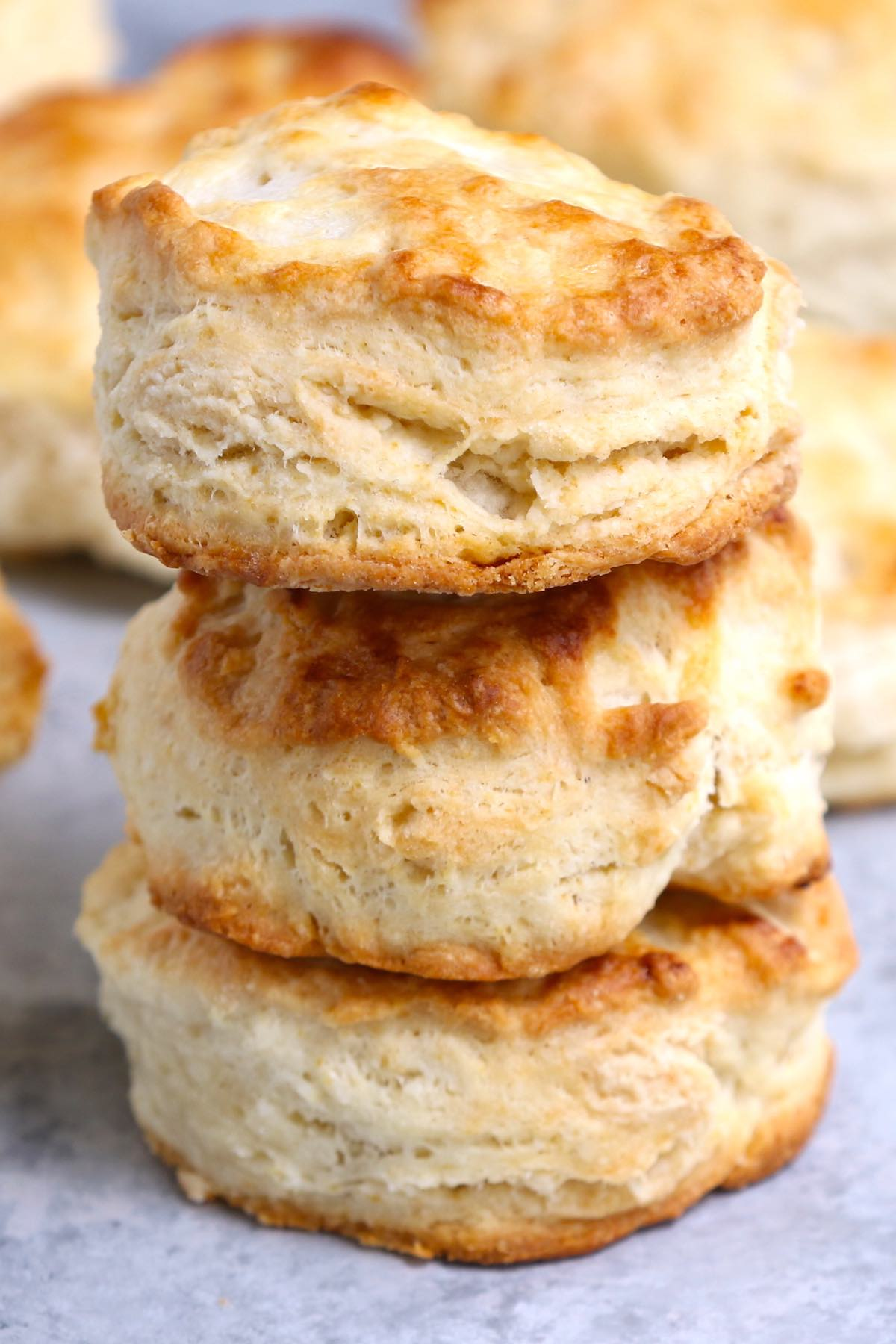 Closeup of Popeyes buttermilk biscuits showing the flaky texture.