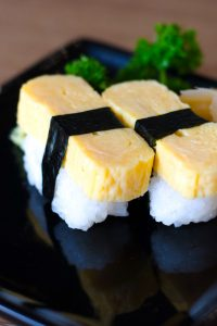 Tamago Sushi is sweet and savory, with a light, fluffy texture. It's made with Japanese rolled omelet (Tamagoyaki) and seasoned sushi rice. This classic egg sushi is a favorite for adults and children alike and is usually served for breakfast or as a side dish in a bento box. Tamagoyaki is also delicious when served on top of sushi rice.