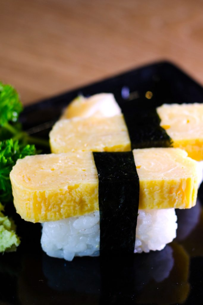 Tamago Sushi is sweet and savory, with a light, fluffy texture. It's made with Japanese rolled omelet (Tamagoyaki) and seasoned sushi rice. This classic egg sushi is a favorite for adults and children alike and is usually served with Japanese breakfasts or as a side dish in a bento box. Tamagoyaki is also delicious when served on top of sushi rice.