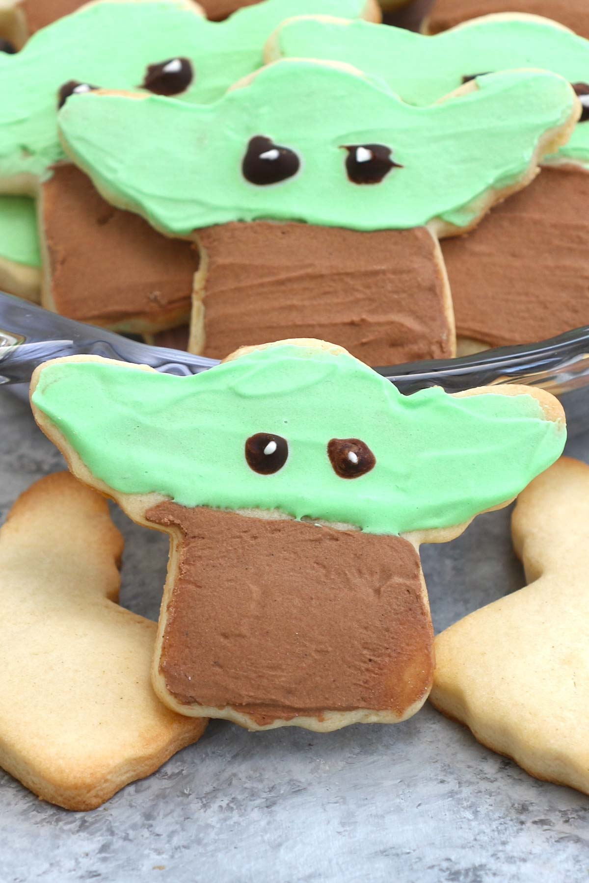 These Baby Yoda Cookies have crisp edges, soft centers, and are decorated with royal icing.  With a simple hack of using a Christmas angel cookie cutter, these adorable sugar cookies are easy to make and look just like the Mandalorian creature when finished. It's all over social media, and popular among Star War fans.