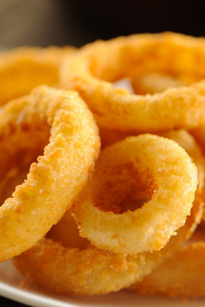 These copycat Burger King Onion Rings are crispy and bursting with savory onion flavors! Made with a few simple ingredients, these homemade onion rings are a perfect side dish, appetizer, or snack for any occasion. Pair them with the onion ring sauce – mouth-watering delicious!