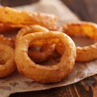 These copycat Burger King Onion Rings are crispy and bursting with savory onion flavors! Made with a few simple ingredients, these homemade onion rings are a perfect side dish, appetizer, or snack for any occasion. Pair them with the onion ring sauce – mouth-watering delicious.