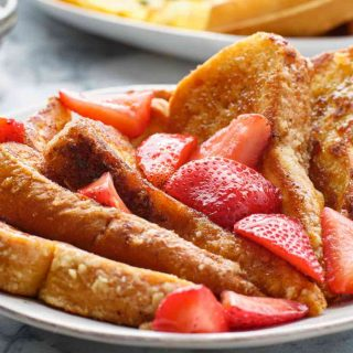 The sweet and buttery IHOP French Toast is super easy to make and perfect for weekend breakfast! The balanced flavors are soaked into brioche bread, with a hint of cinnamon and vanilla. Serve with strawberries or bananas, and this is the recipe your whole family will go crazy for.