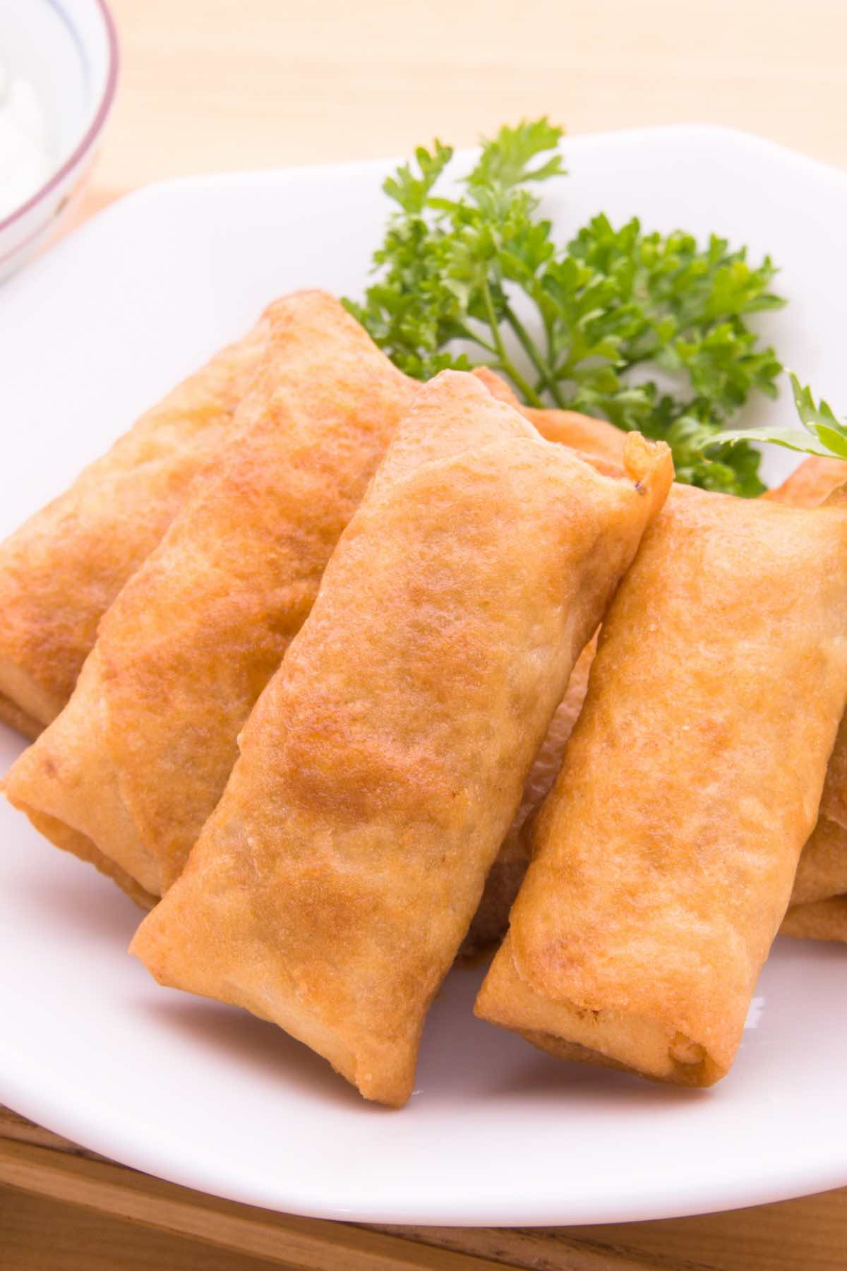 Harumaki is Japanese spring rolls that are crispy on the outside and soft, flavorful on the inside. You'll be surprised how easy it is to make these Japanese spring rolls. Fill the wrappers with your choice of vegetables, pork, chicken, or shrimp, and deep-fry until golden brown. I like to serve them with sweet and sour sauce for dipping, perfect for a light lunch, dinner, or appetizer!