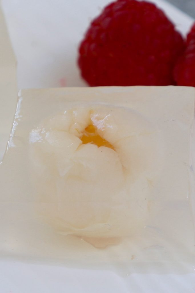 Lychee Jelly is a jiggly Chinese dessert that's made with coconut water, lychee fruits, and agar agar. These delightful vegan sweet cubes are a lovely treat on a hot summer day. You can use gelatin for a non-vegan option. Add it to your iced tea for a fruity alternative to boba bubble tea!