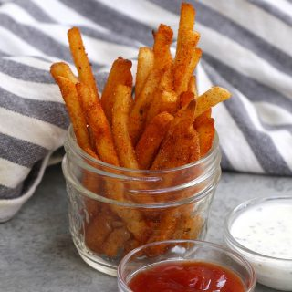These homemade copycat Popeyes' Cajun Fries are crispy on the outside, fluffy on the inside, with the perfect kick. They taste the same if not better than the fast-food French fry. What distinguishes these Popeyes Fries is an irresistible mix of seasonings for an authentic Cajun treat.