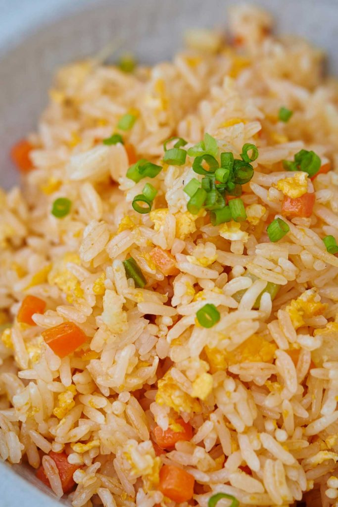 This Japanese restaurant-style Benihana Fried Rice is loaded with delicious veggies and scrambled eggs. Benihana is a popular Tappanyaki restaurant that's an ideal spot for special occasions. The chefs prepare meals right in front of you in a spectacular display of knife work and theatrics. It's actually quite simple to make this copycat recipe at home. Plus, you can easily customize this dish by adding chicken, shrimp or steak.