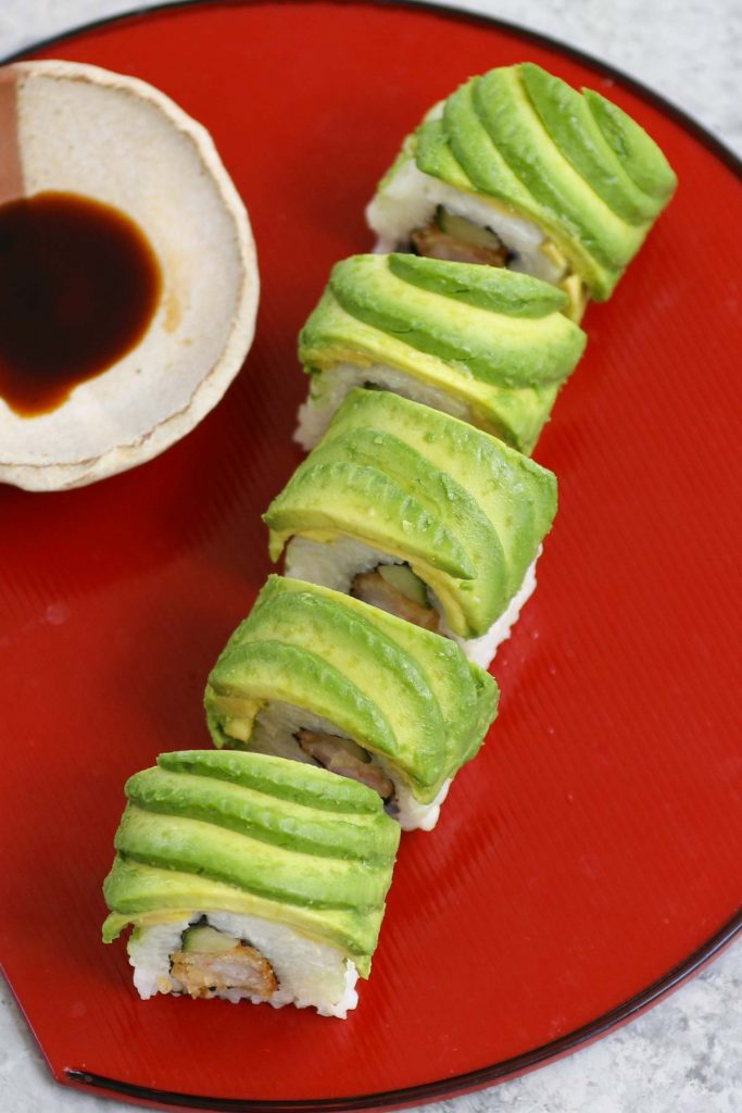 The Dragon Roll is one of the all-time best sushi dishes at Japanese restaurants. Filled with shrimp tempura and cucumber, dragon roll sushi has a delicious avocado topping, resembling the scales of a dragon. We'll share all the tips and tricks so that you can easily make them at home!