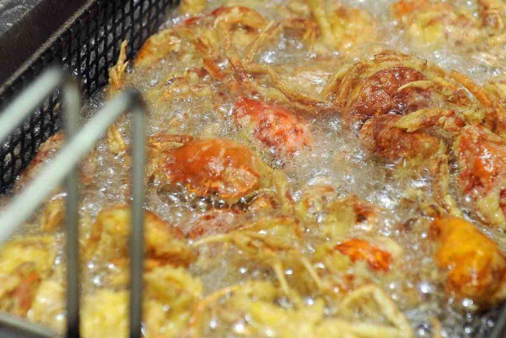 Photo showing frying crab tempura.