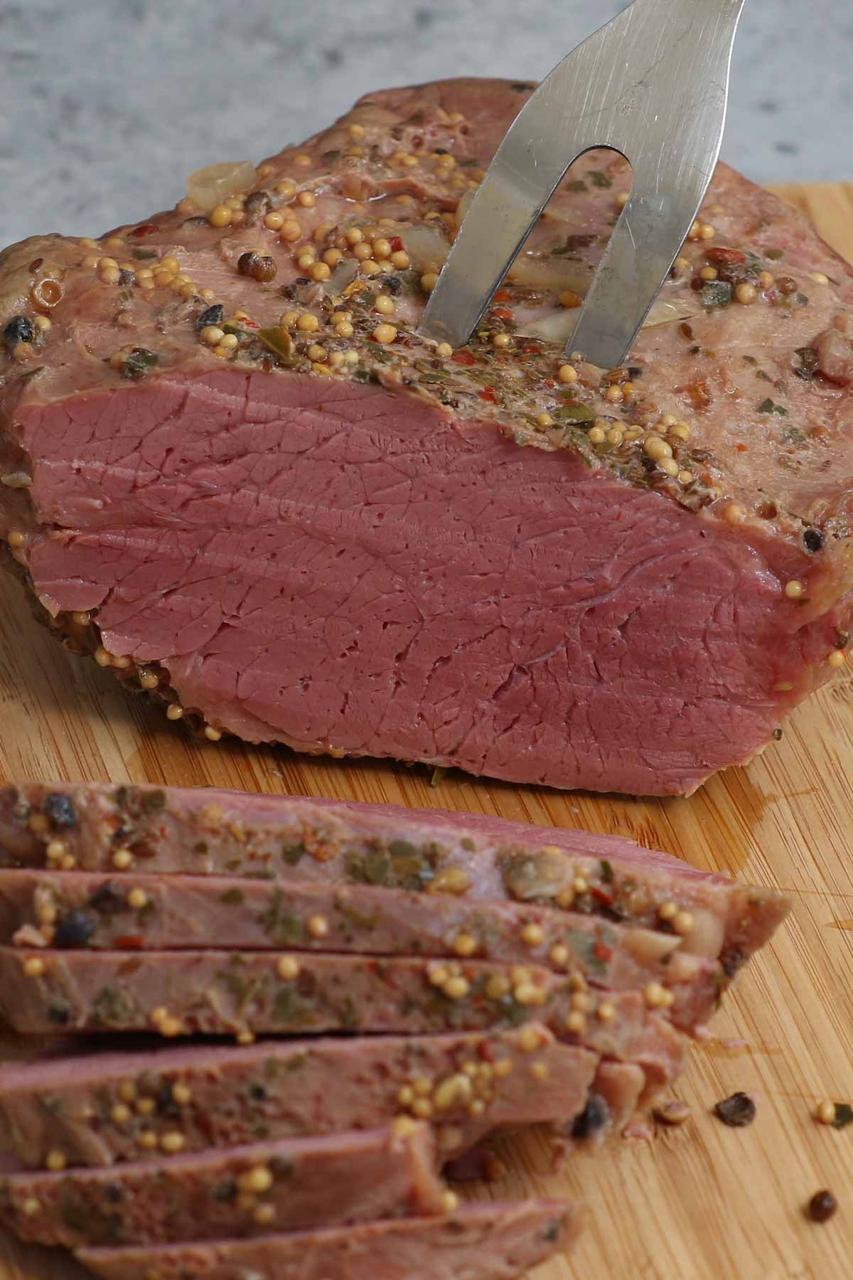 Sous Vide Corned Beef is perfectly tender and full of flavor. The salt-cured corned beef brisket is rubbed with pickling spice, and cooked low and slow in a water bath at 175°F degrees. This Irish staple is sure to be the star of your St. Patrick's Day feast! Serve it with cabbage or make a warm, cheesy Reuben sandwich.