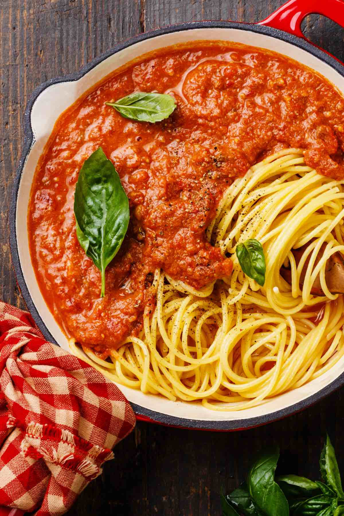 Learn How to Thicken Spaghetti Sauce like a pro! If you find yourself with a watery pasta sauce, you don't need to toss it out and start over again. There are a few quick and simple ways you can reduce your homemade Italian sauce to save it.