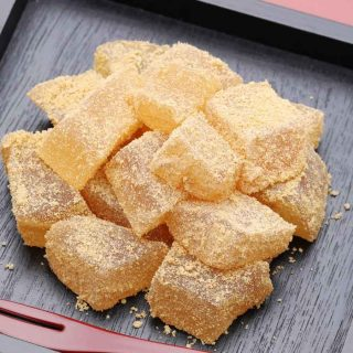 Warabi Mochi is a soft, chewy, and jelly-like confection that you can make with just a few ingredients. It's made with warabiko, different from the mochi made with glutinous flour, but gets its name from the similarity in texture. Warabimochi is often dipped in kinako soybean powder, with an amazing nutty flavor!