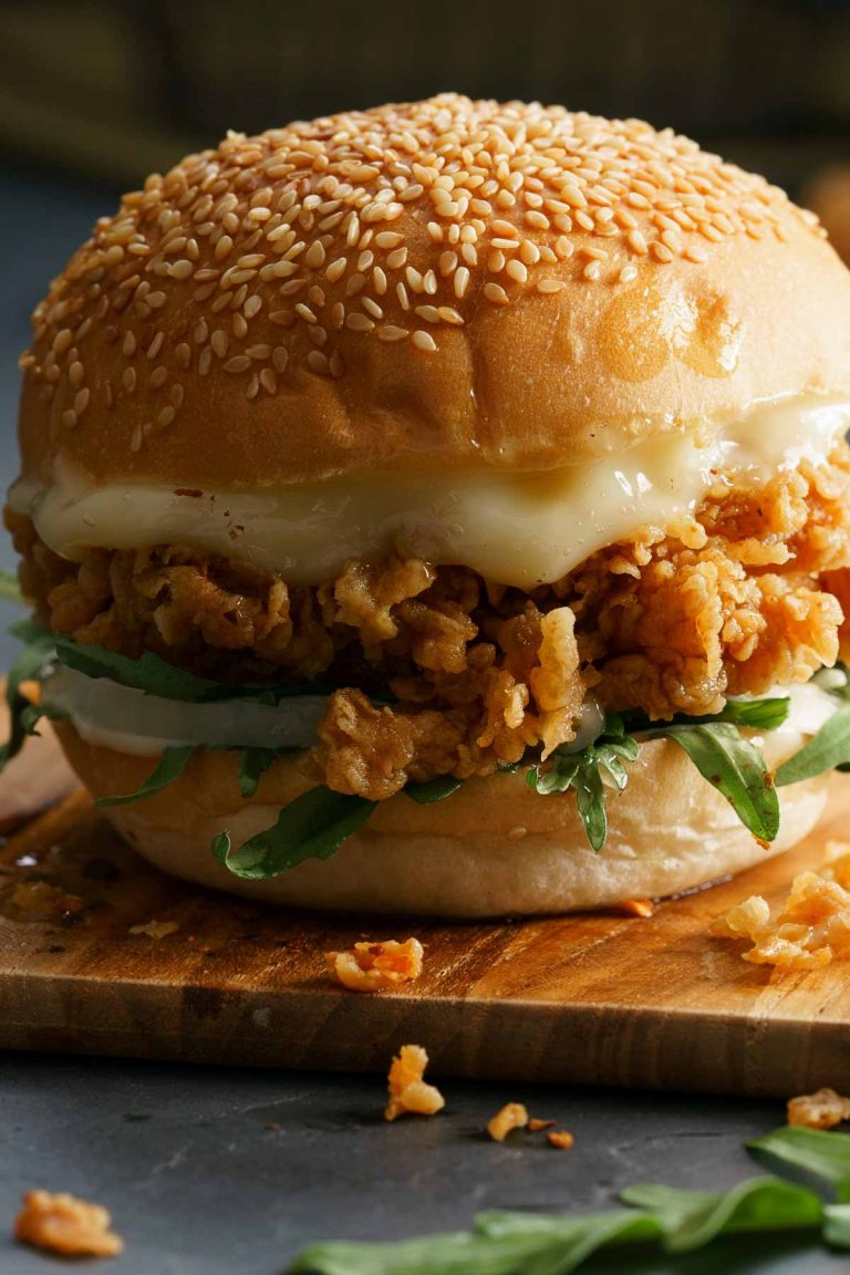 """KFC Zinger Burger or Chicken Burger is the perfect fried chicken sandwich with an added """"Zing!"""" for lovers of a little extra heat. Crispy chicken thighs are balanced by a creamy burger sauce, placed on a toasted brioche bun. This copycat recipe is going to be your most requested meal."""