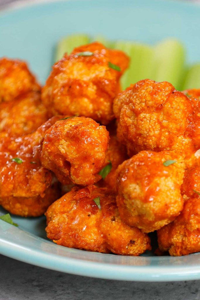 Air Fryer Buffalo Cauliflower is a healthy and low-carb appetizer, snack, or side dish made with NO OIL! These spicy vegan cauliflower bites don't taste like Buffalo wings, but they're definitely healthier with an even better flavor. This is a really easy recipe and takes less than 20 minutes in the air fryer.