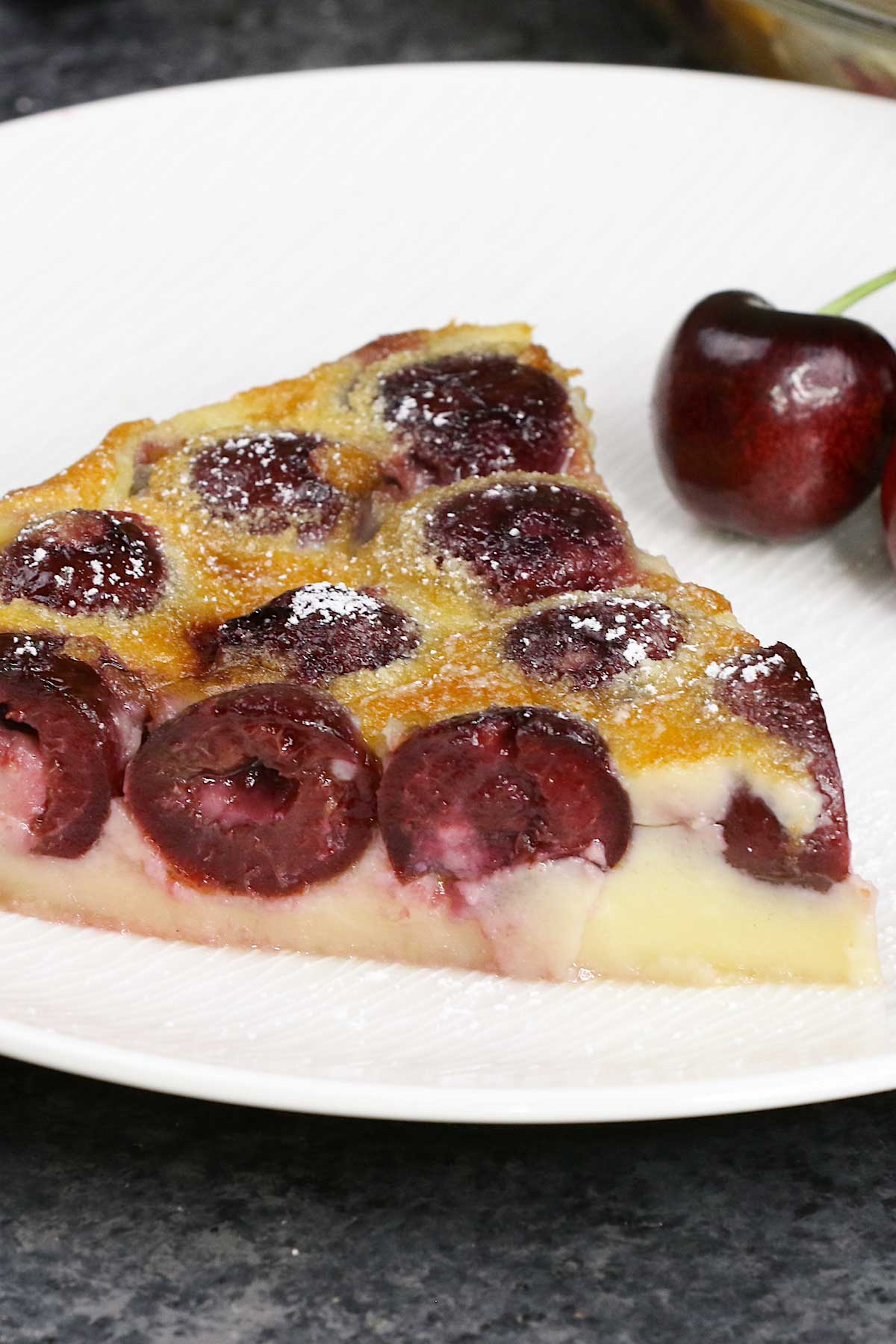 Clafoutis is a classic French dessert that is pleasing to both the eyes and taste buds. Sweet, fresh cherries are baked in a simple batter of milk, sugar, eggs, and flour. The result is a fruity, creamy dessert with a taste similar to custard. You can easily customize this recipe with other fruits like blueberry, raspberry, or apple