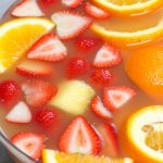 Jungle juice is the easiest, tastiest way to serve drinks at parties, holiday dinners, or for the Super Bowl! This affordable cocktail combines fruit juices and real fruit, with some rum and vodka to get the party started. This punch is sweet, tangy, and refreshing.